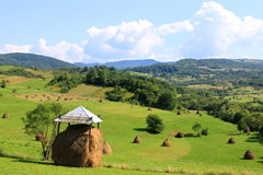 Covered haystack Stock Images