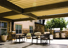 Covered hotel patio with tables Stock Image