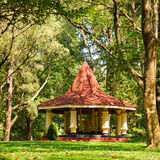 Covered lightweight gazebo in the garden Royalty Free Stock Images