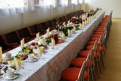 Covered with a long table with food and drink Stock Images