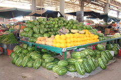 A covered market in Agadir, Morocco. Fruits like melon and water-melon on the foreground Royalty Free Stock Images
