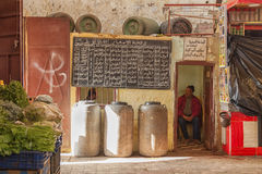 Covered market in Meknes, Morocco. Vendors at covered market in Meknes, Morocco Royalty Free Stock Photo