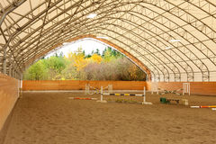 Covered open horse arena with sand. Royalty Free Stock Photo