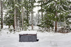 Covered outdoor hot tub surrounded by snow Royalty Free Stock Image