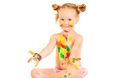 Covered with paint. Joyful little girl covered in paint. Art and painting concept. Happy childhood. Education. Isolated over white background stock photo