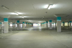 Covered parking lot. An empty parking lot in the building Stock Image