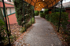 Covered pathway with lanterns Royalty Free Stock Image