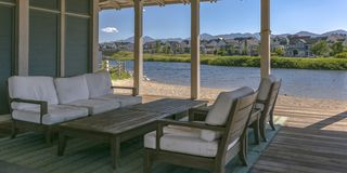 Covered patio beside a lake in Daybreak Utah royalty free stock images