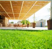 Covered patio or pergola. A ground-level perspective of a covered patio or pergola Stock Images