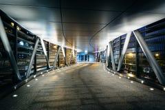 Covered pedestrian bridge at night, in Hong Kong, Hong Kong. Stock Image