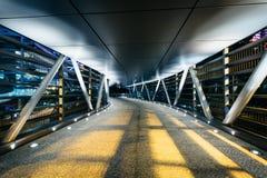 Covered pedestrian bridge at night, in Hong Kong, Hong Kong. Royalty Free Stock Photos