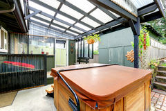 Covered pergola with jacuzzi. And exit to backayrd area Royalty Free Stock Photo