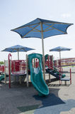 Covered playground with slide Royalty Free Stock Images
