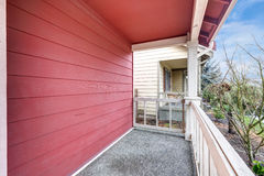 Covered red front porch with railings Royalty Free Stock Photography