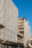 Covered scaffold used in restoring building facade Stock Images