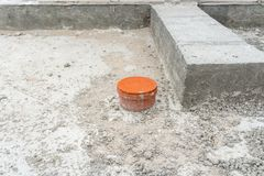 Covered sewer pipe protruding from the foundations of the house being built. Covered sewer pipe protruding from the foundations of the house being built royalty free stock image
