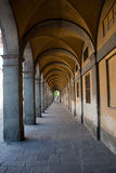Covered sidewalk. Old covered paved pathway with pillars and vaulted roof in Lucca, Tuscany, Italy Stock Images