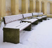 Covered snow bench Royalty Free Stock Photography