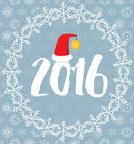 2016 covered with snowflakes on snowy background. 2016 letters with Santa's hat covered with snowflakes on grey snowy background stock illustration