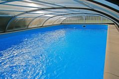 Covered swimming pool. Swimming pool with a roof Stock Photo