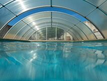Covered swimming pool with an arch