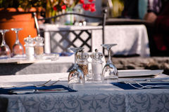 Covered table outside in on a terrace in a restaurant Royalty Free Stock Photography