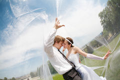 Covered with veil. Kiss of two under the veil Stock Photography