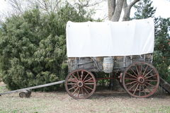 Covered Wagon. A covered wagon sits on display at one on the western ghost towns in Colorado. It is a glimpse into the lives of the pioneers and how they Stock Image
