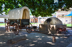 Covered Wagon Exhibit - Sutter`s Fort - Sacramento, CA. Covered wagon and beehive oven in outdoor exhibit at Sutter`s Fort. Sutter`s Fort was a 19th-century Stock Photography