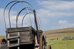 Covered Wagon Facing the Road Ahead stock images