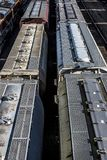 St. Louis, Missouri, United States-circa 2018-covered wagon freight train cars lined up on railroad tracks in trainyard. Covered wagon freight train cars lined Royalty Free Stock Images