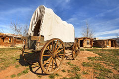 Covered wagon in a pioneers' village. Old covered wagon in a pioneers' village Royalty Free Stock Image