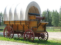Covered Wagon, side view. A very detailed covered wagon minus the tongue, but otherwise complete. Lovely wooden box and wheels covered with a standard canvas Stock Images