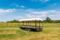 Covered wagon with white top in farm. Stock Photo