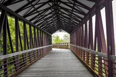 Covered Walking Bridge Crossing Fox River - Saint Charles, IL royalty free stock image