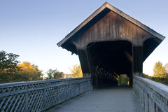 Covered Walking Bridge, Wideangle. A wide angle view of a covered walking bridge, located in Guelph, Ontario, Canada, with a blue sky background and surrounding Royalty Free Stock Photography