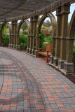 Covered walkway and bench Royalty Free Stock Images