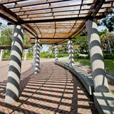 Covered walkway in the park on a Sunny Day Royalty Free Stock Photography