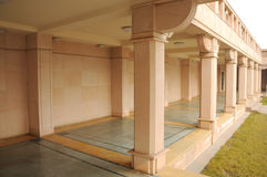 Covered walkway at temple. Covered, outdoor walkway or breezeway with decorative columns at temple Royalty Free Stock Photography