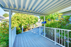 Covered walkway to the house with railings. Royalty Free Stock Photos