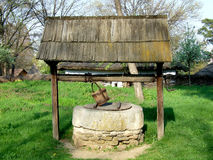 Covered well. Ancient covered well in romanian village Stock Photos