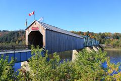Covered Wooden Bridge in Florenceville, New Brunswick. Wooden covered Bridge in Florenceville, New Brunswick, Canada with colorful Autumn trees in the background royalty free stock images