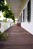 Covered wooden gallery with grapes and benches Royalty Free Stock Photos