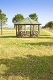 Covered wooden gazebos in a italian countyside Stock Image