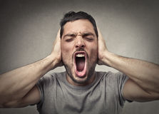 Covering ears Stock Images