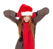 Covering ears shouting woman in red Christmas hat Stock Image