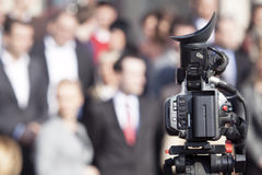 Covering an event with a video camera Royalty Free Stock Image