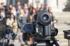 Covering an event with a video camera. Filming an event with a video camera Royalty Free Stock Photos