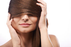 Covering eyes with hair Royalty Free Stock Photo