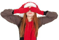 Covering eyes woman in red Christmas hat Royalty Free Stock Images